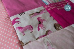 Keepsake quilts with lovely pastels with bright pink accents