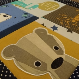 A beautiful cuddle blanket with mustard accents